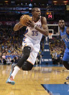 Oklahoma City Thunder small forward Kevin Durant (35) drives past Dallas Mavericks center DeJuan Blair (45) during the second half of an NBA basketball game in Oklahoma City, Wednesday Nov. 6, 2013. (AP Photo/Brett Deering)