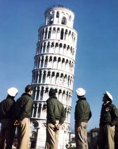 Pilots of the First Brazilian Fighter Squadron pause in front of the Leaning Tower of Pisa while sightseeing during their stay in Italy, 1945. (Photo by PhotoQuest/Getty Images)