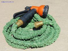 Expanding garden hose with brass connector