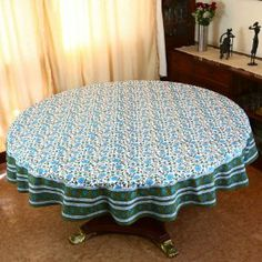 This is a 70 inch diameter round tablecloth in good quality 200 thread count cotton fabric. Artisans of Jaipur have crafted these tablecloths in Indian floral themes and bright spring and summer colors. Both colors and the designs are very pleasing to the eyes. The colors do not bleed and the tablecloths can be washed in machines.