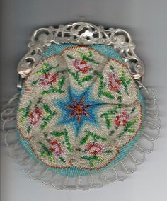 Knitted with antique beads. Antique Silver frame.  Made by Tineke Nieuwenhuijse-Taal.