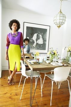 10 Celebrity Dining Rooms You'll Love // Solange Knowles' Brooklyn pad reflects her taste in fashion: cool, casual, and totally unique. We love her rustic wood dining table and her spirited dancing photograph!