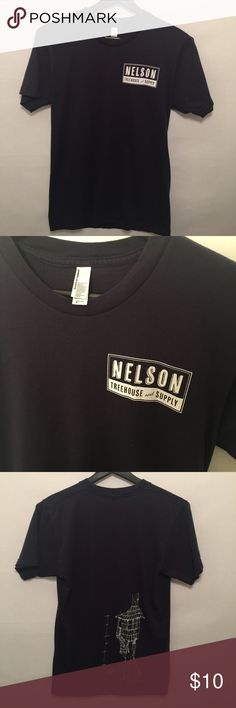 American Apparel Nelson Treehouse and Supply tee. Great condition. Nelson treehouse and supply is part of Treehouse Masters on Animal Planet. Navy blue. American Apparel Tops Tees - Short Sleeve