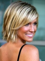 A medium length bob with some layering, and a casual side swept bang.