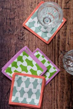Hen House Linens - evans guest house coasters -�set of 6, $30.00 (http://www.henhouselinens.com/evans-guest-house-coasters-set-of-6/)  These are just to cute.