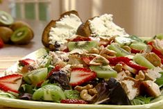 Get Turkey-Mixed Greens Salad with Strawberries, Kiwi and Cashews in Honey-Sesame Dressing Recipe from Food Network