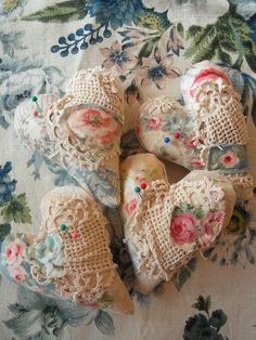 These pin cushions have vintage hand worked crochet lace pieces stitched onto the antique French linen base.