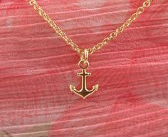 Tiny gold filled anchor necklace. $20.00, via Etsy.