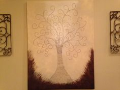 Tree design of bible verses that are within the walls of the house.