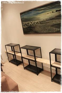 I wanted a Restoration Hardware/Pottery Barn-ish industrial looking shelves for the living room. By taking four units of Hyllis, turning them upside down and making some cuts, we had the basis for