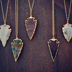 Love these arrowhead necklaces.
