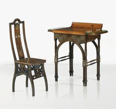 A WALNUT, INLAID WOOD, METAL AND MOTHER-OF-PEARL DESK AND CHAIR BY EUGENIO QUARTI, CIRCA 1898. EACH PIECE SIGNED