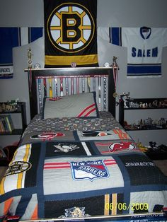 NHL EAST VS WEST Hockey bedroom, Dreaming of the NHL?  Where else could you get a better nights sleep than your own East vs West bedroom.  Highlighting our favorite team the Boston Bruins., hockey stick headboard and NHL East bedding , Boys Rooms Design