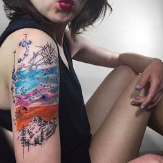 This Modern Tattoo Trend Is So Pretty #refinery29  http://www.refinery29.com/2016/04/109196/watercolor-tattoos#slide-16  We love the way this massive half-sleeve is framed by simple line work at the top and bottom....