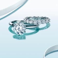 simply classic - round solitaire with platinum band, and diamond eternity band.
