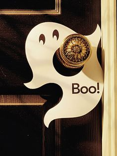 Eerie Ghost Doorknob Hanger  Set a ghostly theme for your haunted house with a simple handmade doorknob hanger. Trace a ghost shape (mimic ours or create your own) onto white cardstock; cut out. Cut a hole in the center for a doorknob, and add eyes and a message with marker (or print them onto the cardstock before cutting out the design).
