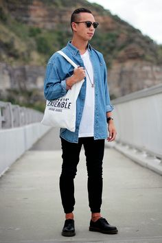 Shop this look for $123:  http://lookastic.com/men/looks/crew-neck-t-shirt-and-denim-shirt-and-tote-and-chinos-and-derby-shoes-and-sunglasses/2591  — White Crew-neck T-shirt  — Blue Denim Shirt  — White Print Canvas Tote  — Black Chinos  — Black Leather Derby Shoes  — Black Sunglasses