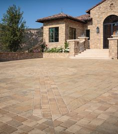 See Belgard's collection of concrete and brick pavers. Explore elegant stone patio pavers, concrete driveway pavers, paver walkways, and hardscape paving stones. Concrete Driveway Pavers, Rock Driveway, Paver Deck, Paver Walkway, Paving Slabs, Driveway Landscaping, Brick Pavers, Circle Driveway, Driveway Ideas