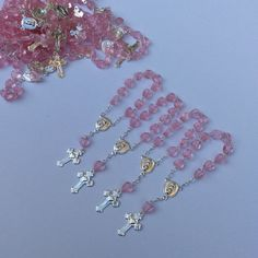 Mini rosaries perfect for baptism favors, approximately 4 long PLEASE NOTICE THAT THEY ARE NOT BRACELETS THEY ARE MINI AND USED ONLY FOR DECORATIONS Available in pink/silver, white/gold and white/silver Price is for 24 pieces. Only the rosaries does not include the bags. You can use them as a baptism favors, first communion. We sell the bags separate.