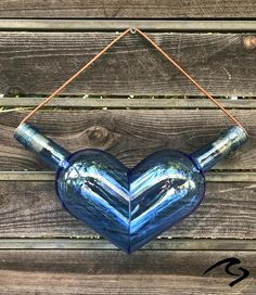 Chubby Heart Wine Bottle Glass Art The post Chubby Heart Wine Bottle Glass Art appeared first on Xup Social. Glass Glue, Glass Bottle Crafts, Wine Bottle Art, Diy Bottle, Wine Bottle Garden, Recycled Glass Bottles, Crafts With Wine Bottles, Beer Bottle, Wine And Liquor