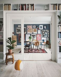 Double doors, book shelves an gallery wall in An Artful And Relaxed Apartment In. Double doors, book shelves an gallery wall in An Artful And Relaxed Apartment In Aarhus, Denmark (+ Get The Look) Decor, Dark Blue Walls, Living Room Decor, My Scandinavian Home, Home Decor, House Interior, Entertaining House, Interior Design, Home And Living