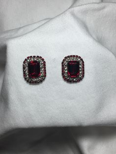 Cute looking earrings in an oval shape. These really pop in most lighted situations. I think these would be stellar for an OSU student, fan, or alum. No back for earrings. They are in pretty good shape, but if you decide to dance heavy the cent...