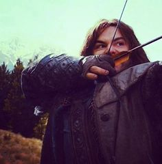 He might as well be an elf....i mean he's like the only one who does archery, everyone else has like a sword or something.