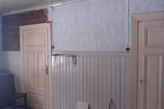 Here it is how it was before we started with the kitchen. Starting tapistry/wallpaper removal on left.