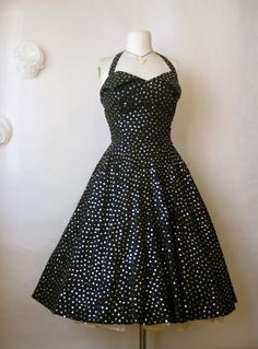 "a jaw-dropping gorgeous vintage 1950s dress. nice quality cotton in black covered in silver sequins. they sparkle and shine so much! sweetheart layered ""petal"" bust with boning - so flattering. button in halter straps so you can remove them for a strapless look. full circle skirt with amazing volume and a rear metal zipper"