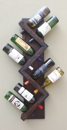 Wine racks from wooden wall shelf in zig zag shape