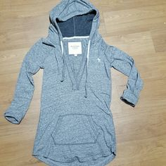 Abercrombie & Fitch shirt. Hooded, V- Neck, with a front pocket, cuffed 3/4 sleeves. Shorter in front and longer in the back. Very soft. Great condition. Rarely worn. Abercrombie & Fitch Tops Tees - Long Sleeve