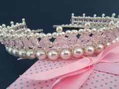 measures 3/4 inch and was created using 4mm and 8mm white glass pearl beads and 8mm pale pink crystal barrels all attached to a silver toned tiara band.