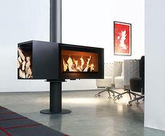 TURN/skantherm  http://www.skantherm.de/de/kaminoefen/kaminofen/turn//info  Feuer ist immer in Bewegung. Seine Flammen drehen und wenden sich in stetem Spiel umeinander. Genau das kann auch »turn«. Der um bis zu 360° drehbare Kaminofen lässt sich stufenweise arretieren und ist die Antwort auf offenes Wohnen.