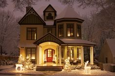 beautiful restored Victorian home in the snow / holidays.  so pretty