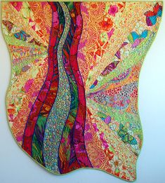"""""""Dream in Flight"""" quilt by Linda Reinert. Inspired by Dreaming in Color by Kaffe Fassett. Cover to Cover Book Club Quilters."""