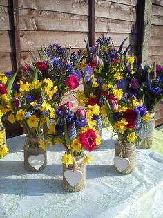 Jam jars bursting with spring flowers