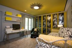 A sunburst flush mount light fixture adds drama and glamour to this teen bedroom. The white sawhorse desk with chrome legs creates a stylish workspace. Graphic black and white patterned curtains and bedding bring  sophisticated touches to the space.