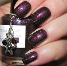 The Lady Varnishes Mistress of All Evil swatched on nail wheel.  $6 shipped.  With charm, scented.  Shauna Daniele