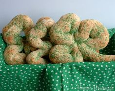 Sweet St Patty's Day treat to make with the kids - Shamrock Pretzels Recipe:    1 1/4 cup water  3 1/2 cup flour  1 teaspoon salt  1 egg, seperated  1 tablespoon oil  2 tablespoons sugar  1 teaspoon lemon juice  1 tablespoon active dry yeast  Cinnamon and sugar mixture to sprinkle on top  Green Sugar to sprinkle on top