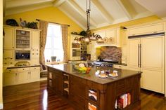 Country kitchens can be bright and airy with white cabinets and appliances accented with cobalt blue tile and accessories. However, a country kitchen can also be warm and inviting filled with earth tones and wood furniture and accented with warm shades of red, gold, green, brown, and creme. Wood flooring is just one of the styles of flooring you can choose for this kitchen decorating scheme. Opt for natural, eco-friendly materials that will look fantastic and wear well over time. Fabrics for farmhouse style kitchens should compliment the colors of your furniture and accessories. White eyelet lace, homespun plaid fabrics, and gingham prints are popular choices for kitchen window treatments, tablecloths, napkins, or chair cushions. Plain linen or cotton curtains can easily be stenciled by hand to match your theme.