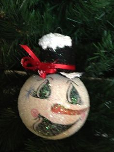 Snowman Christmas ornament painted by madge vanity bulb