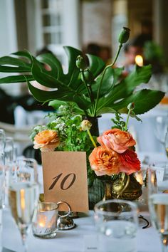 Ferns and peach florals for a contemporary table centerpiece. Photo by Shannen Natasha of The Wedding Artist Collective