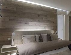Reclaimed barn wood bedroom wall in gray / Barnwood Naturals, LLC www.barnwoodnaturals.com
