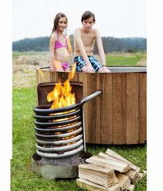Discover thousands of images about My current DIY hottub - bath temp degrees) in 4 hours, just a wood fire inside pipe spiral. Hot water rises and draws in cooler water from below making thermal circulation. Outdoor Baths, Stock Tank, Rocket Stoves, Outdoor Living, Outdoor Decor, Outdoor Projects, Diy Projects, Wooden Diy, Diy Wood