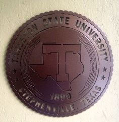 """Tarleton State Seal~Wall Badge - 18""""- cut from 11ga steel-(.115)-right at an 1/8"""" thick. Hanger welded on the back. It has a baked on powder coat finish (Coppervein) - $99.00 plus tax (Texas only) - and shipping ~JDH Iron Designs www.starsovertexas.com email me: jimmydon@starsovertexas.com or call or text 254 749 2925"""