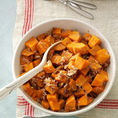Coconut-Pecan Sweet Potatoes Recipe -These delicious sweet potatoes cook effortlessly in the slow cooker so you can tend to other things. Coconut gives this classic a fresh twist. —Raquel Haggard, Edmond, Oklahoma