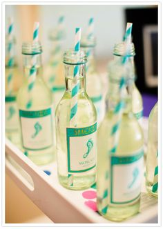 mini wine bottles with straws! cute shower idea.