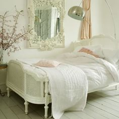 LOVE the modern lamp with the traditional French bed!