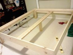 I wanted a proper bed frame for our California king bed. It had been on a metal frame that was getting old, and was starting to dip on the...