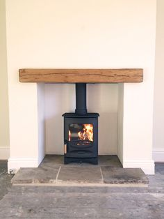 C-Four, oak fireplace beam, reclaimed Yorkshire stone hearth.Charnwood C-Four, oak fireplace beam, reclaimed Yorkshire stone hearth. Wood Burner Fireplace, Small Fireplace, Fireplace Hearth, Fireplace Surrounds, Wood Mantle, Wood Burner Stove, Floating Fireplace, Cottage Fireplace, Fireplace Shelves
